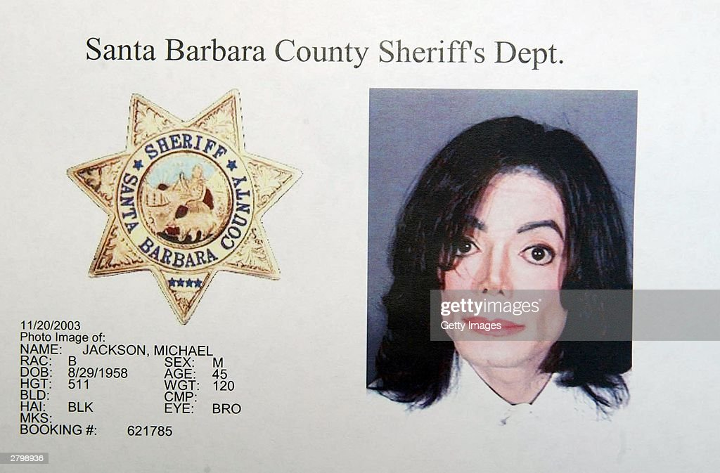 In this handout image provided by the Santa Barbara County Sheriff's Office, singer <a gi-track='captionPersonalityLinkClicked' href=/galleries/search?phrase=Michael+Jackson&family=editorial&specificpeople=70011 ng-click='$event.stopPropagation()'>Michael Jackson</a> is shown in a mug shot after he was booked on multiple counts for allegedly molesting a child November 20, 2003 in Santa Barbara, California.