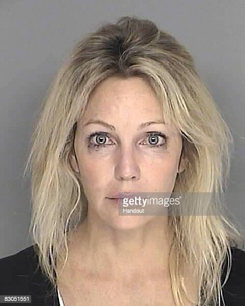 In this handout image provided by the Santa Barbara County Sheriff's Dept actress Heather Locklear poses for a mugshot September 28 2008 in Santa...
