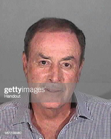 In this handout image provided by the Santa Monica Police Department, NBC sportscaster Al Michaels is seen in a police booking photo after his arrest for driving under the influence of alcohol April 19, 2013 in Santa Monica, California.