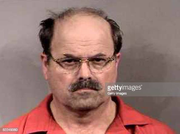 In this handout image provided by the Sedgwick County Sheriff's office BTK murder suspect Dennis Rader stands for a mug shot released February 27...