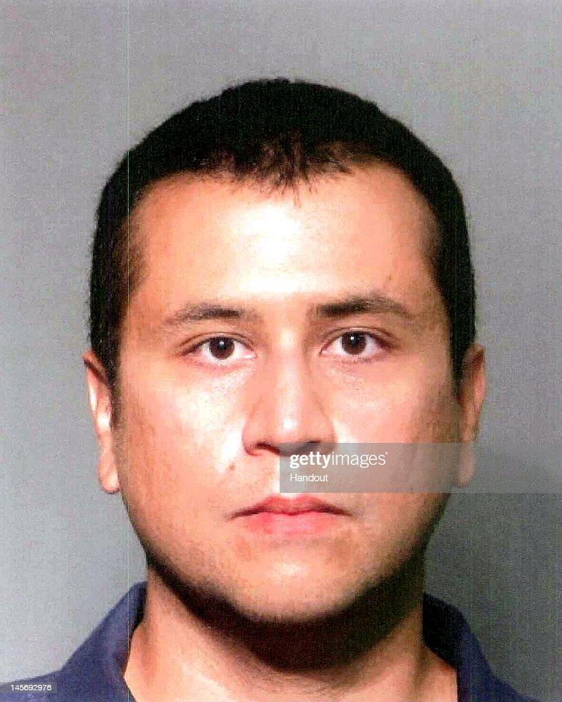 In this handout image provided by the Seminole County Sheriff's Office George Zimmerman poses for a mugshot photo following his surrender to...