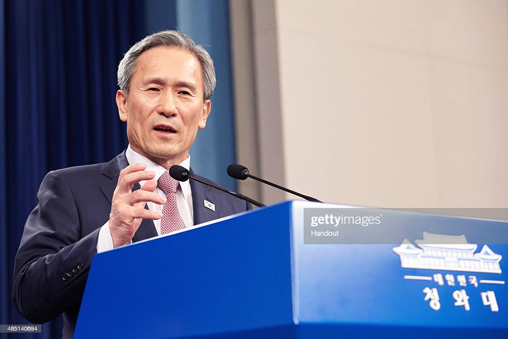 In this handout image provided by the South Korean Presidential Blue House, South Korean presidential security adviser <a gi-track='captionPersonalityLinkClicked' href=/galleries/search?phrase=Kim+Kwan-Jin&family=editorial&specificpeople=4112030 ng-click='$event.stopPropagation()'>Kim Kwan-Jin</a> speaks during a press conference after meeting with North Korean counterparts at the presidential blue house on August 25, 2015 in Seoul, South Korea. Both countries came to an agreement to ease tensions after an exchange of artillery fire last week.