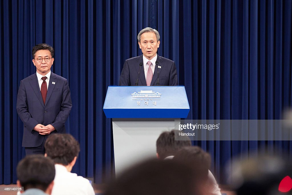 In this handout image provided by the South Korean Presidential Blue House, South Korean presidential security adviser <a gi-track='captionPersonalityLinkClicked' href=/galleries/search?phrase=Kim+Kwan-Jin&family=editorial&specificpeople=4112030 ng-click='$event.stopPropagation()'>Kim Kwan-Jin</a> speaks during a press conference after meeting with North Korean counterpart at the presidential blue house on August 25, 2015 in Seoul, South Korea. Both countries came to an agreement to ease tensions after an exchange of artillery fire last week.