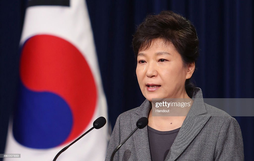 In this handout image provided by the South Korean Presidential Blue House, South Korean President Park Geun-Hye weeps during an address to the nation about the sunken ferry Sewol at the presidential Blue House on May 19, 2014 in Seoul, South Korea.