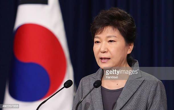 In this handout image provided by the South Korean Presidential Blue House South Korean President Park GeunHye weeps during an address to the nation...