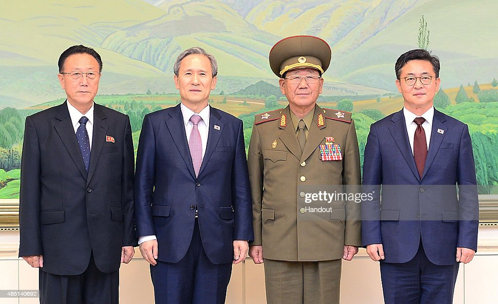 In this handout image provided by the South Korean Unification Ministry, (L to R) <a gi-track='captionPersonalityLinkClicked' href=/galleries/search?phrase=Kim+Yang-Gon&family=editorial&specificpeople=4679241 ng-click='$event.stopPropagation()'>Kim Yang-Gon</a>, a senior North Korean official responsible for South Korean affairs, South Korean presidential security adviser <a gi-track='captionPersonalityLinkClicked' href=/galleries/search?phrase=Kim+Kwan-Jin&family=editorial&specificpeople=4112030 ng-click='$event.stopPropagation()'>Kim Kwan-Jin</a>, Hwang Pyong So, North Korea' top political officer for the Korean People's Army and South Korean Unification Minister Hong Yong-Pyo, pose after the meeting at the Panmunjom on August 25, 2015 in Paju, South Korea. Both countries came to an agreement to ease tensions after an exchange of artillery fire last week.