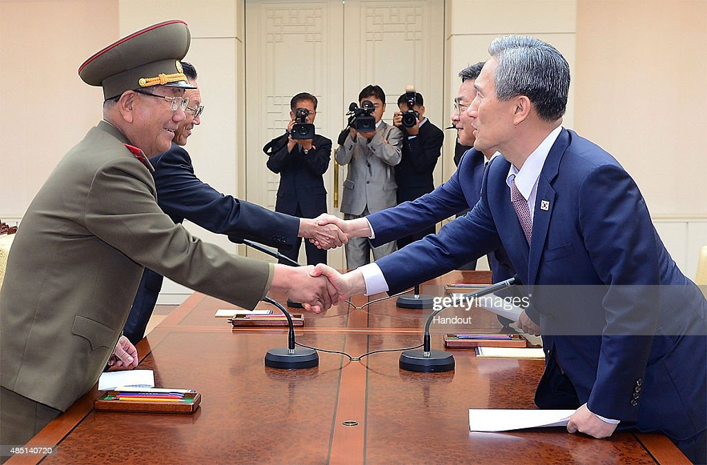 In this handout image provided by the South Korean Unification Ministry, South Korean presidential security adviser <a gi-track='captionPersonalityLinkClicked' href=/galleries/search?phrase=Kim+Kwan-Jin&family=editorial&specificpeople=4112030 ng-click='$event.stopPropagation()'>Kim Kwan-Jin</a> (R), <a gi-track='captionPersonalityLinkClicked' href=/galleries/search?phrase=Hwang+Pyong-So&family=editorial&specificpeople=13629767 ng-click='$event.stopPropagation()'>Hwang Pyong-So</a> (L) North Korea' top political officer for the Korean People's Army, South Korean Unification Minister Hong Yong-Pyo (2nd R) and <a gi-track='captionPersonalityLinkClicked' href=/galleries/search?phrase=Kim+Yang-Gon&family=editorial&specificpeople=4679241 ng-click='$event.stopPropagation()'>Kim Yang-Gon</a> (2nd L) a senior North Korean official responsible for South Korean affairs shake hands after their meeting at the Panmunjom on August 25, 2015 in Paju, South Korea. Both countries came to an agreement to ease tensions after an exchange of artillery fire last week.