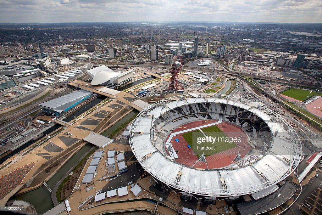 In this handout image provided by the The London Organising Committee of the Olympic Games an aerial view of the Olympic Stadium Aquatics Centre and...