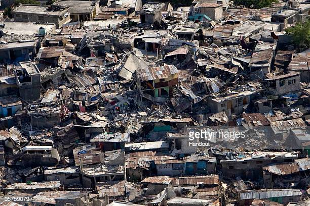 In this handout image provided by the United Nations a poor neighbourhood shows the damage after an earthquake measuring 70 rocked the Haitian...