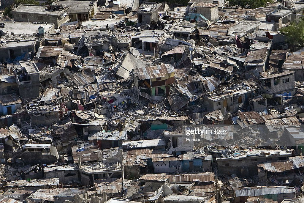 In this handout image provided by the United Nations Houses in a poor neighborhood sit destroyed after an earthquake on January 13 2010 in...