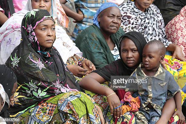 In this handout image provided by the United Nations internally displaced people sit outside the main mosque on April 5 2014 in Bangui Central...