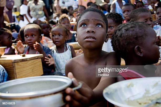 In this handout image provided by the United Nations Stabilization Mission in Haiti children eat their daily meals distributed by the United Nations...