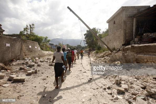 In this handout image provided by the United Nations Stabilization Mission in Haiti the World Food Programme begins its first day of distributing...