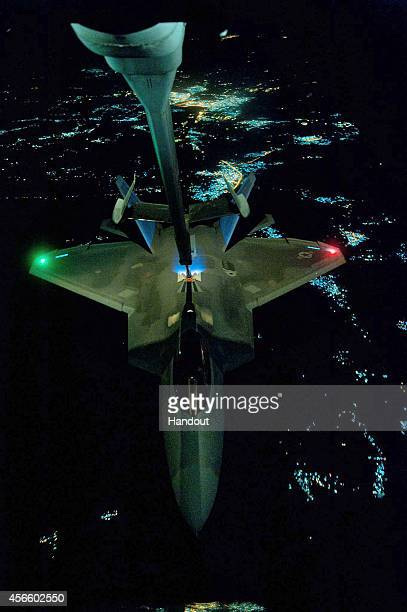 In this handout image provided by the US Air Force A KC10 Extender refuels an F22 Raptor fighter aircraft prior to strike operations in Syria during...