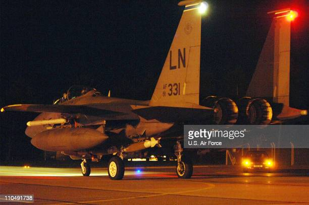 In this handout image provided by the US Air Force An F15E Strike Eagle taxis down the runway prior to departure from RAF Lakenheath in preparation...