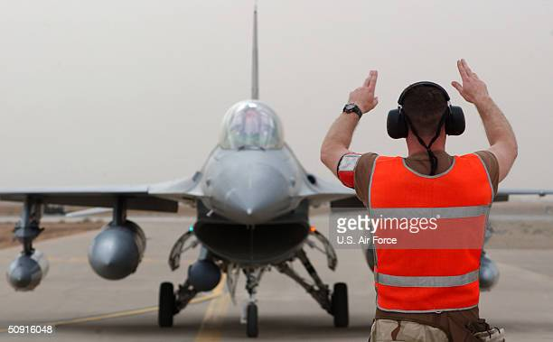 In this handout image provided by the US Air Force Technical Sgt Robert Algeo a Weapons Load Crew Chief taxis in an F16 from the Colorado Air...