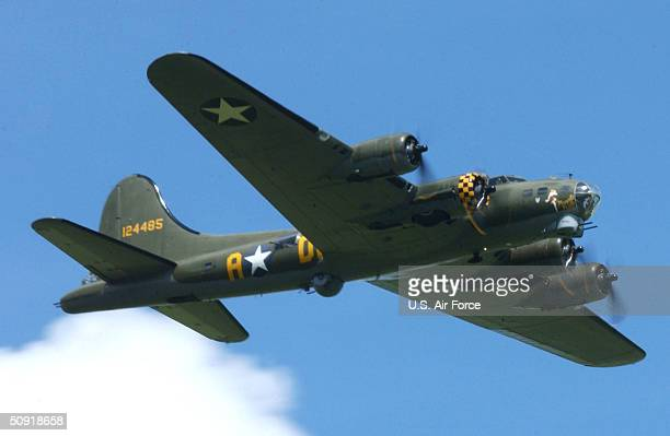In this handout image provided by the US Air Force the 'Sally B' B17 Flying Fortress performs flybys during the Memorial Day ceremony held at...