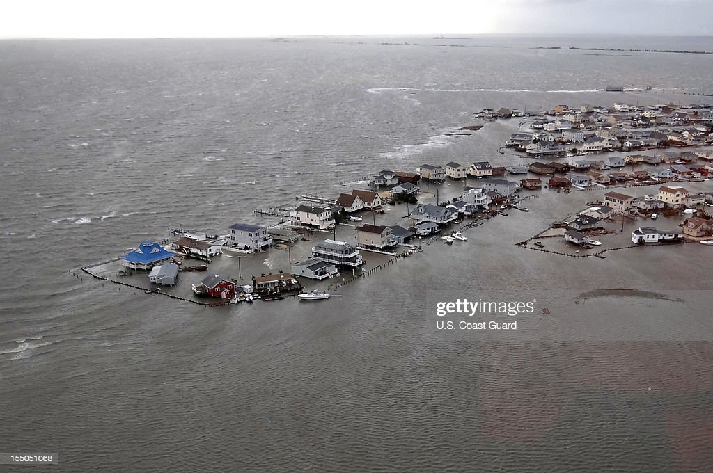 In this handout image provided by the U.S. Coast Guard, homes are flooded after Hurricane Sandy made landfall on the southern New Jersey coastline October 30, 2012 in Tuckerton, New Jersey. The storm has claimed many lives in the United States and has caused massive flooding across much of the Atlantic seaboard. U.S. President Barack Obama has declared the situation a 'major disaster' for large areas of the U.S. east coast, including New York City, with widespread power outages and significant flooding in parts of the city.