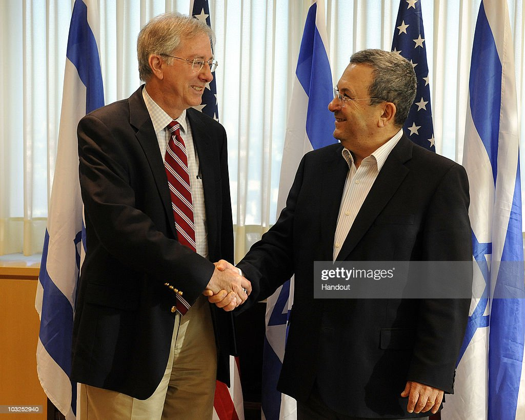In this handout image provided by the U.S. Embassy Tel Aviv, Dennis Ross, Special Assistant to the President and Director for the Central Region at the National Security Council, with Israeli Minister of Defense Ehud Barak after their meeting, on August 5, 2010 at the MOD in Tel Aviv.