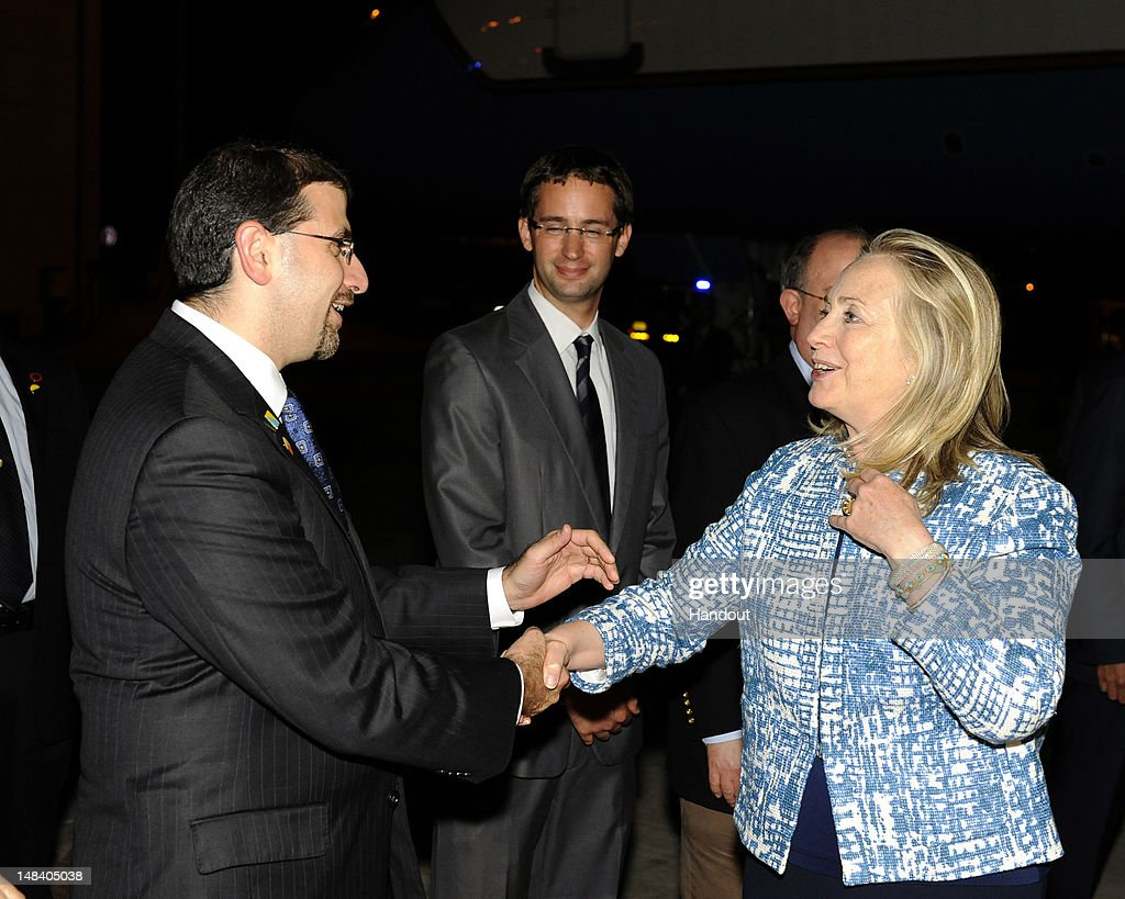 In this handout image provided by the U.S. Embassy Tel Aviv, Secretary of State <a gi-track='captionPersonalityLinkClicked' href=/galleries/search?phrase=Hillary+Clinton&family=editorial&specificpeople=76480 ng-click='$event.stopPropagation()'>Hillary Clinton</a> is greeted by Ambassador Dan Shapiro (L) as she arrives in Israel for an official visit, on July 15, 2012 at the Ben Gurion International Airport in Tel Aviv, Israel. <a gi-track='captionPersonalityLinkClicked' href=/galleries/search?phrase=Hillary+Clinton&family=editorial&specificpeople=76480 ng-click='$event.stopPropagation()'>Hillary Clinton</a> is visiting the region during her 8-nation tour to meet with Israeli officials and is expected to discuss Iran's nuclear program.