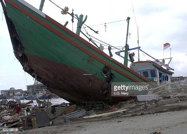 In this handout image provided by the US Navy a large boat lies among the rubble following a devastating December 26 2004 tsunami January 17 2005 in...