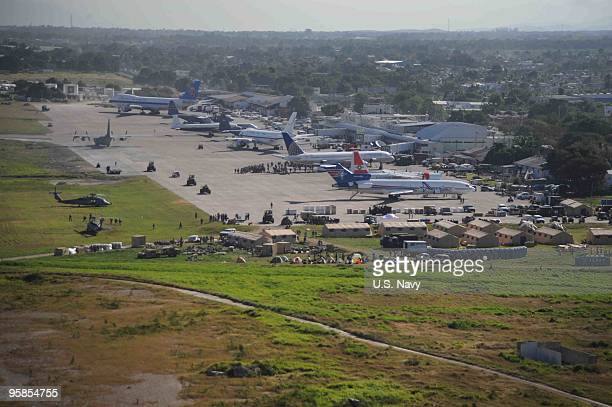 In this handout image provided by the US Navy Airplanes wait for offload to support in earthquake relief efforts at the PortauPrince International...