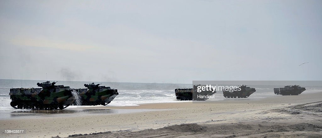 In this handout image provided by the U.S. Navy, Amphibious assault vehicles (AAV) from the amphibious transport dock ship USS Oak Hill make their way toward the shore during a Bold Alligator 2012 amphibious landing exercise on Feb. 6, 2012 in Camp Lejeune, North Carolina. Bold Alligator 2012, the largest naval amphibious exercise in the past 10 years, represents the Navy and Marine Corps' revitalization of the full range of amphibious operations and will last through Feb. 12, 2012 afloat and ashore in and around Virginia and North Carolina.