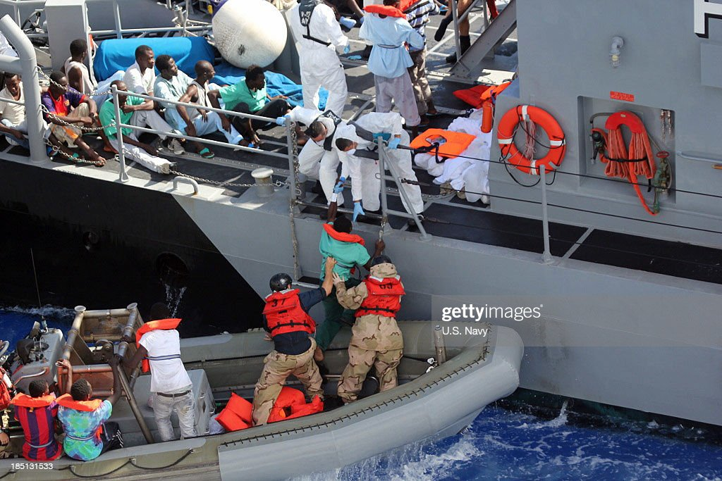 In this handout image provided by the U.S. Navy, distressed persons depart the amphibious transport dock ship USS San Antonio after being transferred to an Armed Forces of Malta offshore patrol vessel October 17, 2013 in the Mediterranean Sea. San Antonio provided food, water, medical attention, and temporary shelter to the 128 men who were rescued October 16 from an inflatable raft that was adrift after responding to a call by the Maltese Government.