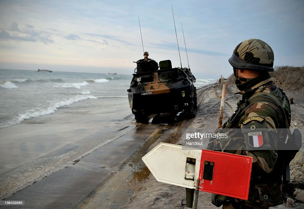 In this handout image provided by the U.S. Navy, French forces practice an amphibious landing during a Bold Alligator 2012 amphibious landing exercise on Feb. 6, 2012 in Camp Lejeune, North Carolina. Bold Alligator 2012, the largest naval amphibious exercise in the past 10 years, represents the Navy and Marine Corps' revitalization of the full range of amphibious operations and will last through Feb. 12, 2012 afloat and ashore in and around Virginia and North Carolina.