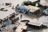 In this handout image provided by the US Navy homes remain flooded after four storms in one month have devastated the area and killed more than 800...