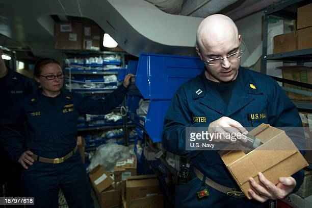 In this handout image provided by the US Navy Lt Dustin Porter a physician aboard the aircraft carrier USS George Washington inventories available...