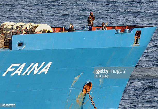 In this handout image provided by the US Navy Somali pirates holding the merchant vessel MV Faina stand on the deck of the ship after a US Navy...