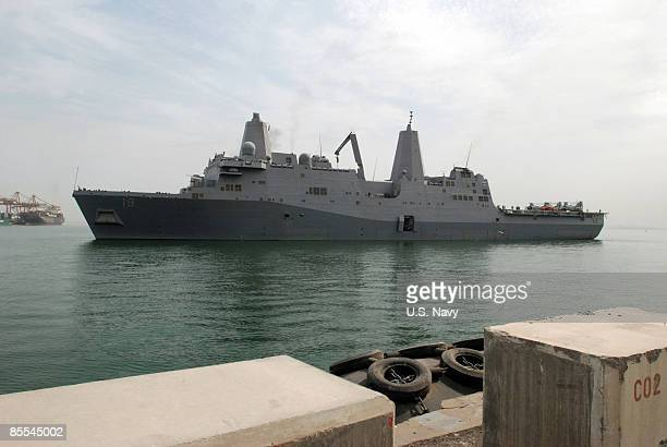 In this handout image provided by the US Navy the amphibious transport dock ship USS New Orleans pulls into Mina Salman pier where US Navy engineers...