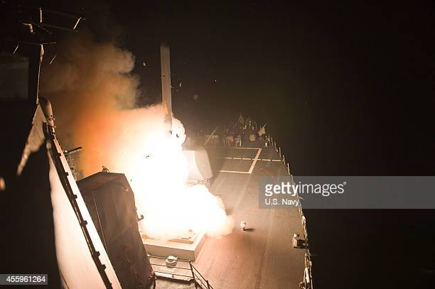 In this handout image provided by the US Navy The guidedmissile destroyer USS Arleigh Burke launches Tomahawk cruise missiles on September 23 2014 in...
