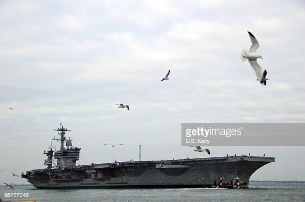 In this handout image provided by the US Navy the Nimitzclass aircraft carrier USS Carl Vinson departs Naval Station Norfolk January 12 2010 of the...