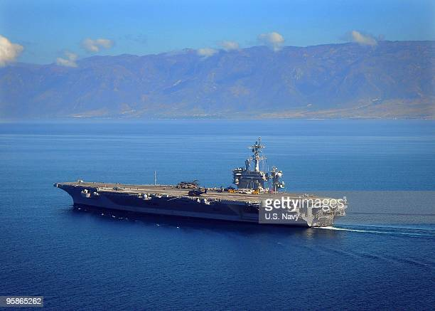 In this handout image provided by the US Navy The Nimitzclass aircraft carrier USS Carl Vinson maneuvers on January 18 2010 in PortAuPrince off the...
