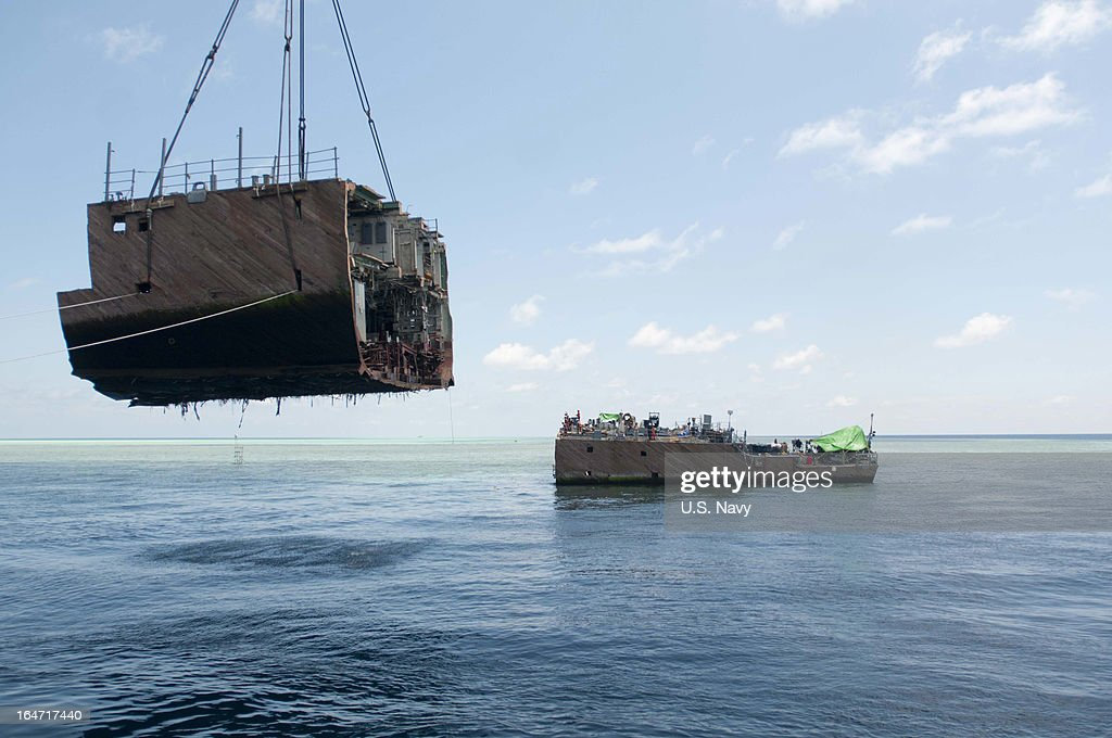 In this handout image provided by the U.S. Navy, the U.S. Navy contracted crane vessel M/V Jascon 25 removes a hull section from the mine countermeasure ship ex-Guardian (MCM 5) on March 26, 2013 in Sulu Sea, Philippines. The U.S. Navy and contracted salvage teams continue damage assessments and the removal of equipment and parts to prepare the grounded ship to be safely dismantled. The U.S. Navy continues to work in close cooperation with the Philippine authorities to safely dismantle Guardian from the reef while minimizing environmental effects. Guardian ran aground on the Tubbataha Reef January 17.
