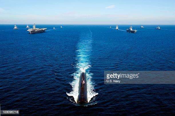In this handout image provided by the US Navy US Navy and South Korean ships sail in a 13ship formation led by the Los Angelesclass attack submarine...