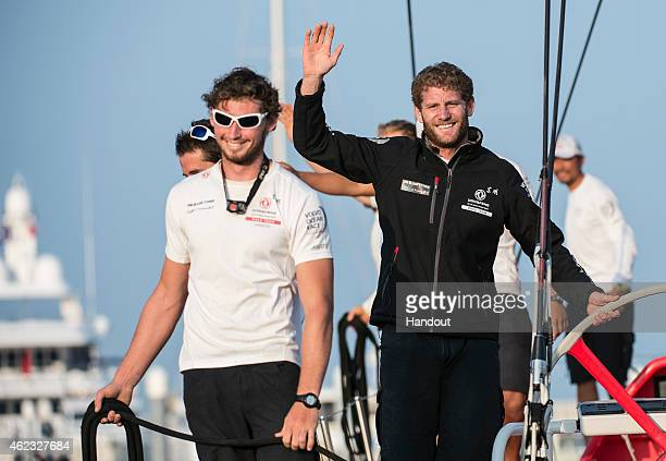In this handout image provided by the Volvo Ocean Race Dongfeng Race Team celebrate after they arrive in Sanya in first position leader of Leg 3...
