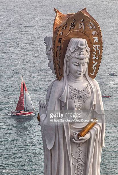 In this handout image provided by the Volvo Ocean Race Dongfeng Race Team pass the waypoint by the statue Guanyin during the start of Leg 4 from...