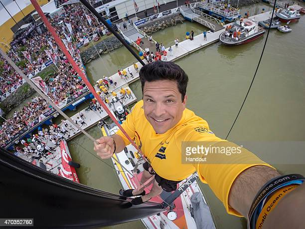 In this handout image provided by the Volvo Ocean Race English television comedian and journalist Dom Joly at the top of the mast of Abu Dhabi Ocean...