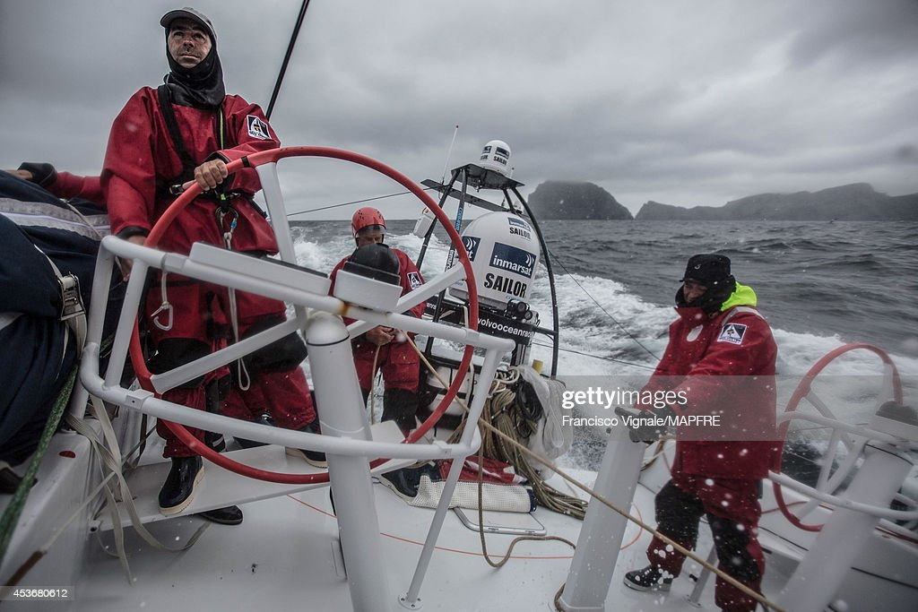 In this handout image provided by the Volvo Ocean Race, Gonzalo Araujo stands at the helm as the Spanish team skippered by Iker Martinez compete in the Sevenstar Round Britain and Ireland race with their new Volvo Ocean 65 on August 13, 2014 in an unspecified location at sea. The Volvo Ocean Race will start from Alicante in Spain on October 04, 2014, the 38,739-nautical mile route includes stopovers in Cape Town (South Africa), Abu Dhabi (UAE), Sanya (China), Auckland (New Zealand), Itaja (Brazil), Newport, RI, (USA), Lisbon (Portugal) and Lorient (France). A 24-hour pit-stop in The Hague is scheduled between France and the race finish in Sweden. The Volvo Ocean Race is the world's premier ocean yacht race for professional racing crews.