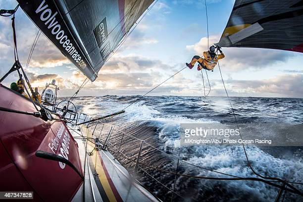 In this handout image provided by the Volvo Ocean Race Leg 5 to Itajai onboard Abu Dhabi Ocean Racing Luke 'Parko' Parkinson swings out over the...