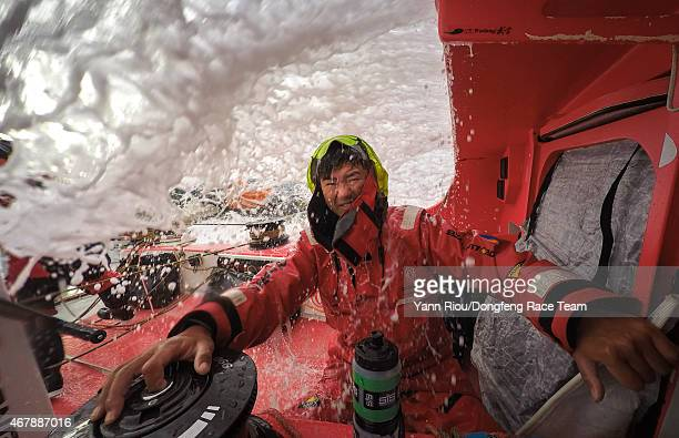In this handout image provided by the Volvo Ocean Race Leg 5 to Itajai onboard Dongfeng Race Team Jiru Yang 'Wolf' is wet and cold 'When I have to...