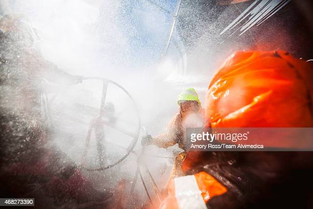 In this handout image provided by the Volvo Ocean Race Leg 5 to Itajai onboard Team Alvimedica Fast upwind conditions mean a lot of spray over the...