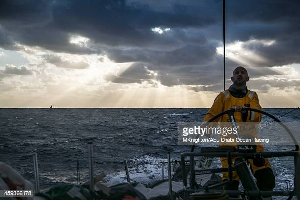 In this handout image provided by the Volvo Ocean Race onboard Abu Dhabi Ocean Racing sunlight breaks through the clouds at dusk revealing another...