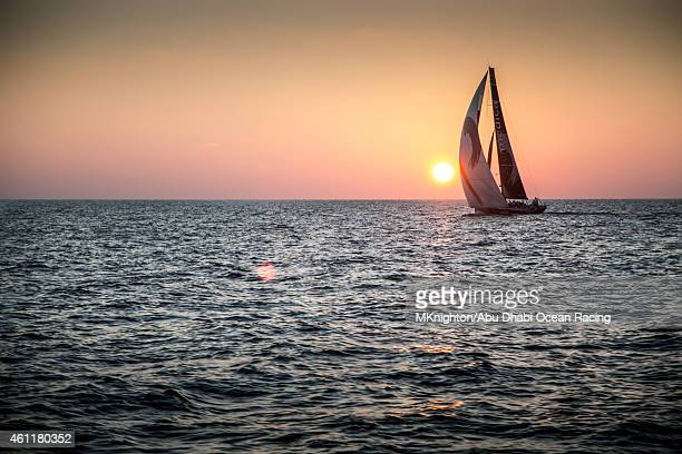 In this handout image provided by the Volvo Ocean Race onboard Abu Dhabi Ocean Racing A silhouetted Team Alvimedica behind an Indian Ocean Sunset as...