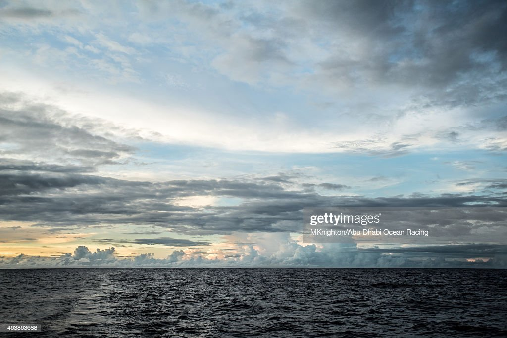 In this handout image provided by the Volvo Ocean Race onboard Abu Dhabi Ocean Racing Ring of thunderclouds on the horizon at dusk during Leg 4 from...