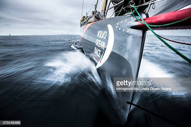 In this handout image provided by the Volvo Ocean Race onboard Abu Dhabi Ocean Racing Azzam streaks through the water as the team leaves for Leg 6...