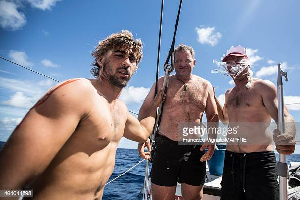 In this handout image provided by the Volvo Ocean Race onboard MAPFRE The 'no more virgins' Rafael Trujillo and Willy Altadill with King Neptune in...